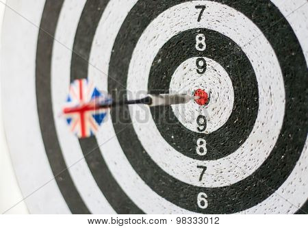 Darts board one Great Britain flag arrow