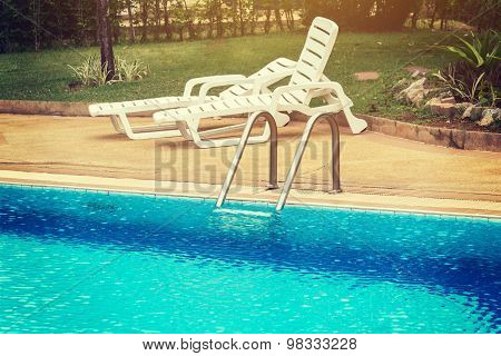 Swimming Pool With Stair At Hotel Vintage.