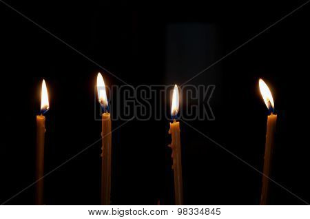 Four Alight Candles