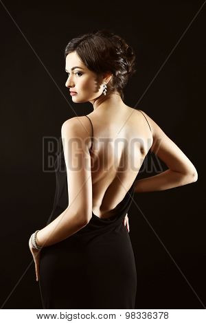 Pretty woman with bare back on dark background