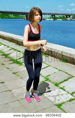 Young woman jogging near river