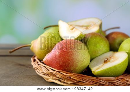 Ripe tasty pears on bright background
