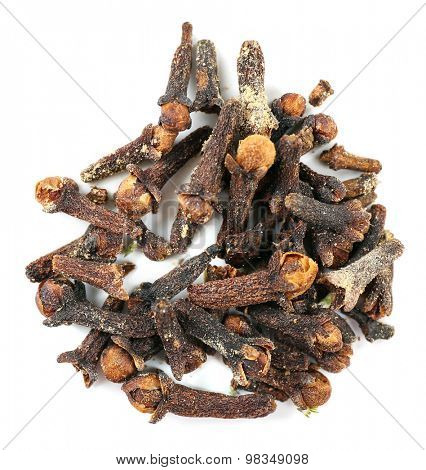 Pile of dried clove spice isolated on white