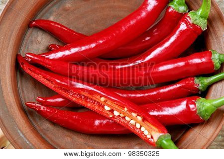 Hot peppers in bowl close up
