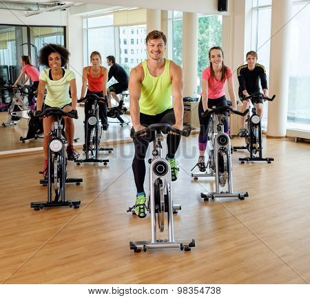 Multiracial group during aerobics class on a bicycles