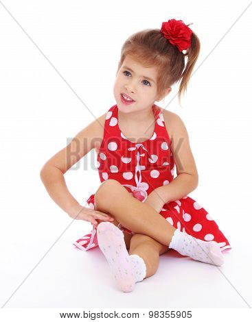 Beautiful little girl in a red dress