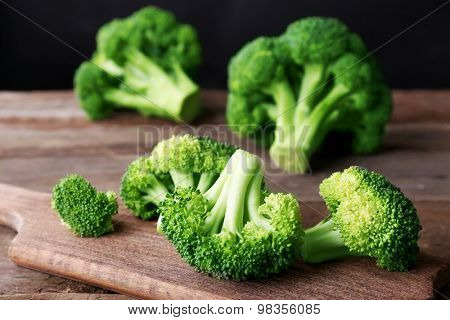 Fresh broccoli on wooden table close up