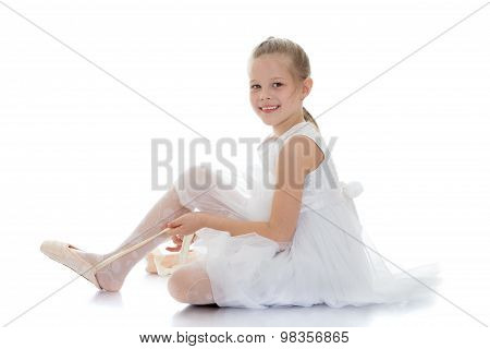 The dancer wears shoes