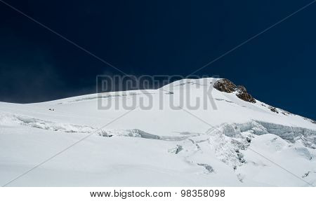 Mountain ridge covered with snow.