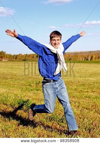 Happy Teenager In The Field