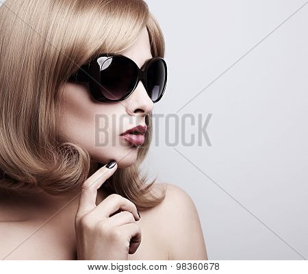 Trendy Model Profile In Fashion Sunglasses With Blond Short Hairstyle Looking. Toned Closeup Portrai