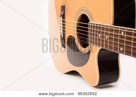 Electric acoustic yellow guitar close up isolated on white