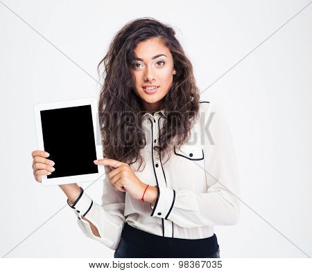 Happy businesswoman pointing finger on tablet computer isolated on a white background. Looking at camera