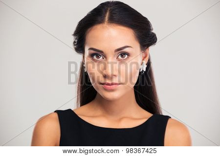 Jewerly concept. Portrait of a lovely young woman looking at camera isolated on a white background