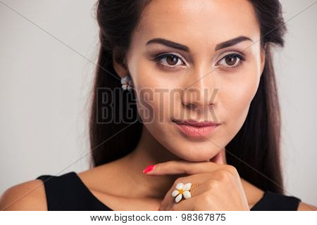 Jewerly concept. Closeup portrait of a beautiful female model posing isolated on a white background