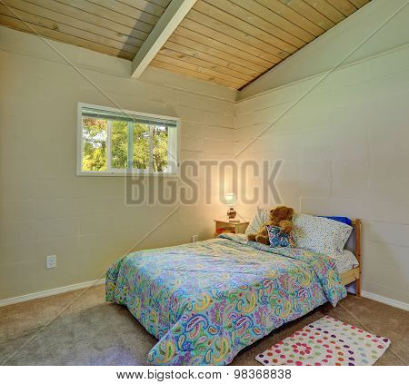 Girls Bedroom With Decorative Bedding.
