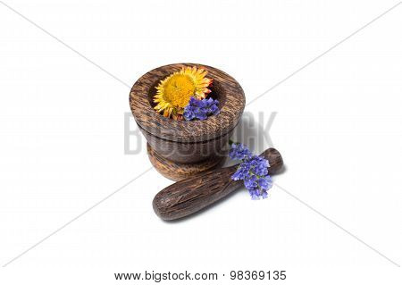 Wooden pounder with yellow and blue flowers