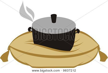 Comfort food cooking pot on pillow