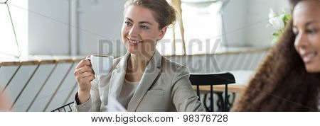 Drinking Coffee During Meeting