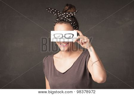 Happy girl looking with hand drawn eye glasses paper concept