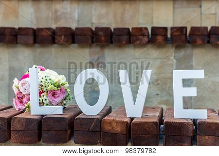 Bouquet Of Flowers And An Inscription Love