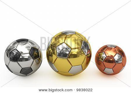 Golden, Silver And Bronze Soccer Balls On White