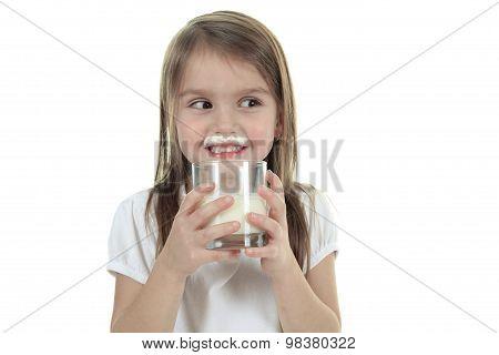 Little girl drinking milk on white background