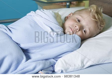 sick little boy in a hospital bed