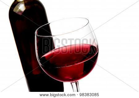 Red Wine Glass Near Wine Bottle