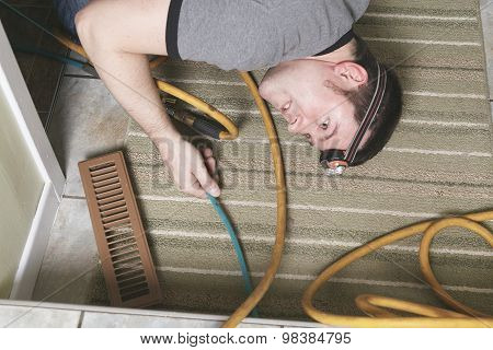 ventilation cleaner man at work with tool