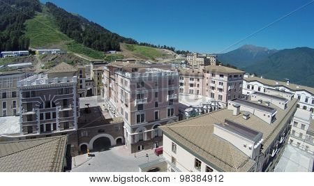 SOCHI, RUSSIA - AUG 1, 2014: Hotel Gorky Grand located at an altitude of 960 meters above sea level in the resort of Gorky Gorod in Krasnaya Polyana, landscape with a birds eye view