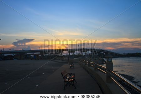 Colorful sunset and Bridge over river