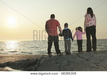 A Family of four member by a sunset