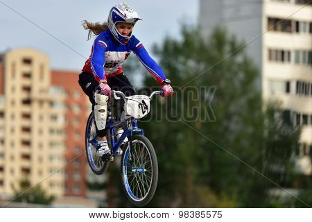 ST. PETERSBURG, RUSSIA - AUGUST 6, 2015: Unidentified female biker in the BMX race Cruiser. The competitions is a stage of the BMX racing championship of Russia