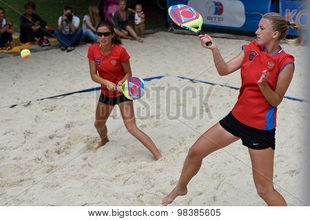 MOSCOW, RUSSIA - JULY 18, 2015: Irina Glimakova (right) and Julia Chubarova of Russia in the semifinal match of the Beach Tennis World Team Championship against Brazil. Russia won the match 2-1