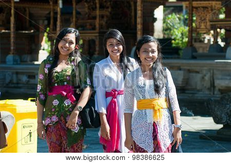 BALI, INDONESIA, APRIL 10 2013: Hindu girls after praying in Turta Empul temple on APRIL 10, 2013 in Bali, Indonesia. Turtal Empul temple is one of the most famous hindu temple in Bali island