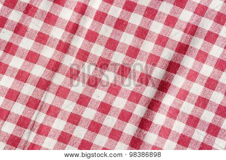 Red and white picnic tablecloth texture.