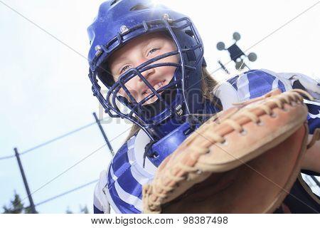 A baseball catcher at the sun light