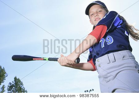A Baseball girl hitter over a blue sky