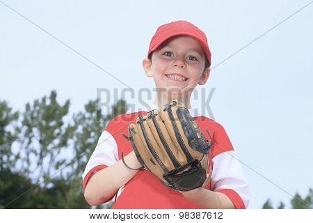 A nice child happy to play baseball