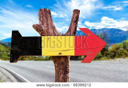Belgium Flag wooden sign with road background