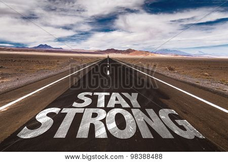 Stay Strong written on desert road