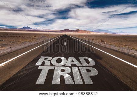 Road Trip written on desert road
