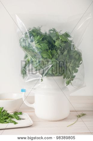 properly stored fresh herbs - in water and wrapped in plastic bag
