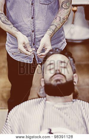 Barber Hands Choosing Razor