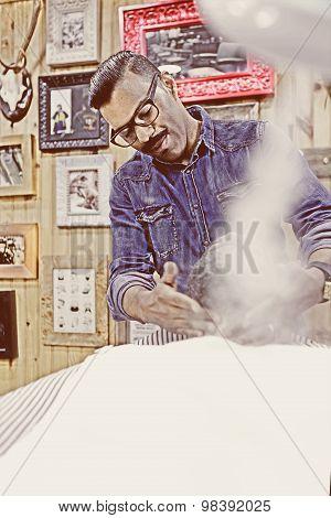 Barber Steaming A Beard
