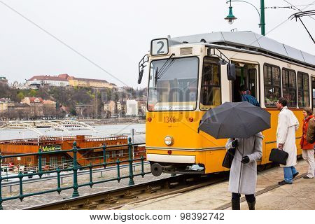 Yellow Tram Number 2, People On The Tram Stop In Budapest, Hungary