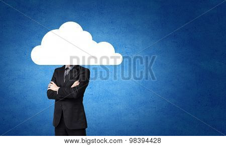 Businessman standing with his head in cloud