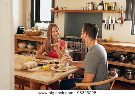 Couple Having Chat At Breakfast Table
