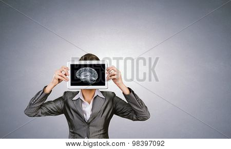 Woman holding tablet pc with brain concept